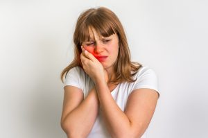 Woman suffering from toothache isolated on white background